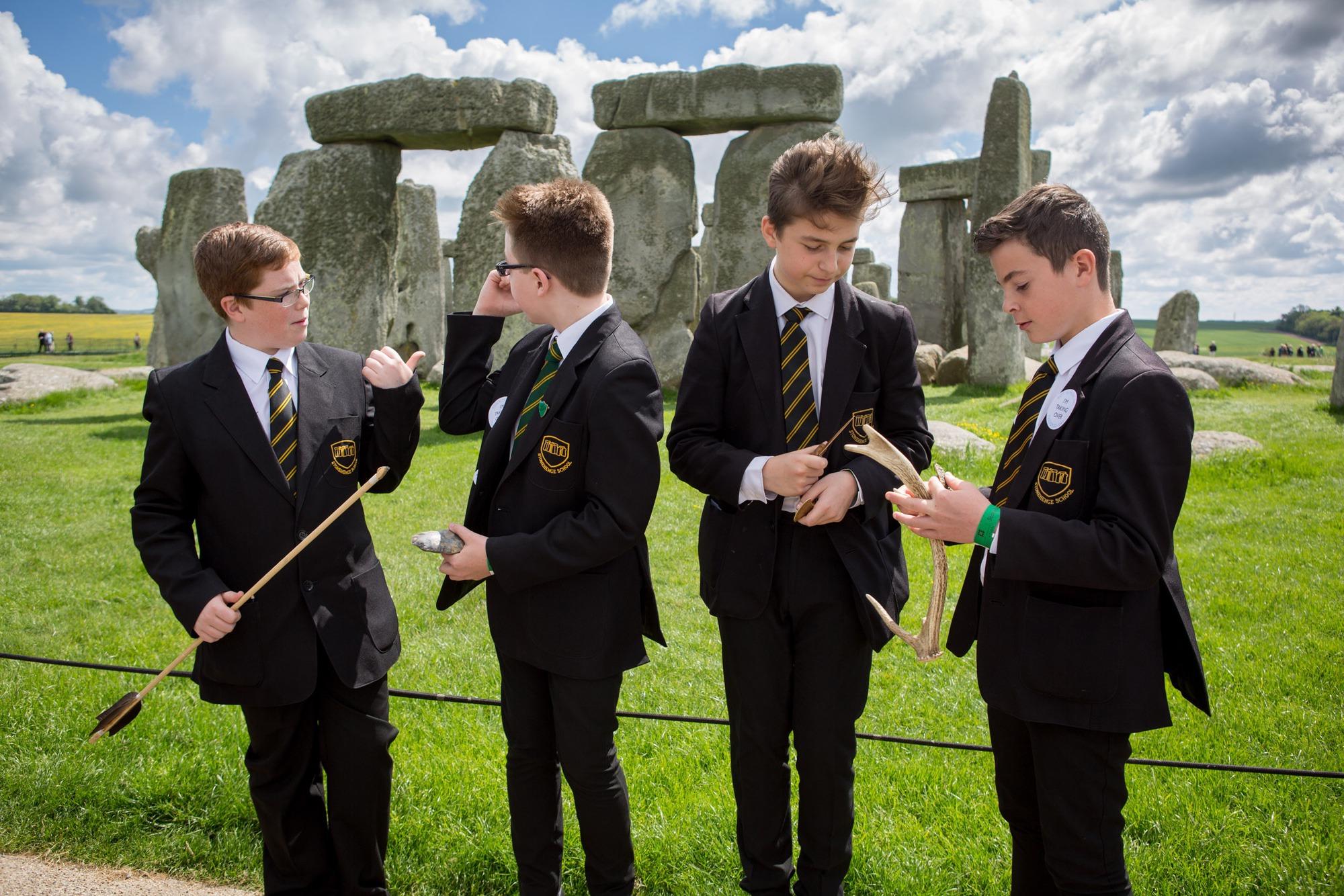 Four boys at Stonehenge