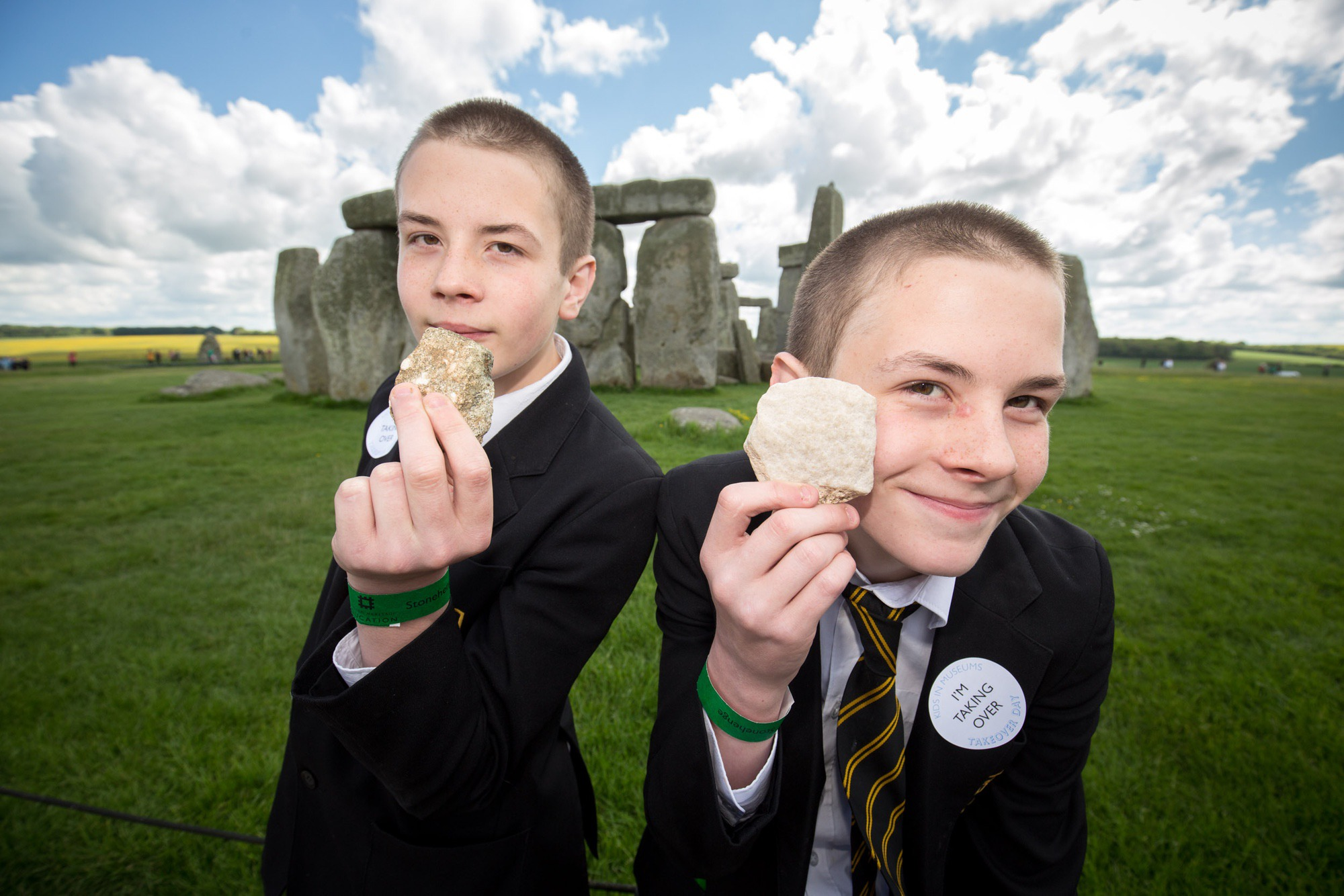 Two boys with rocks at Stonehenge