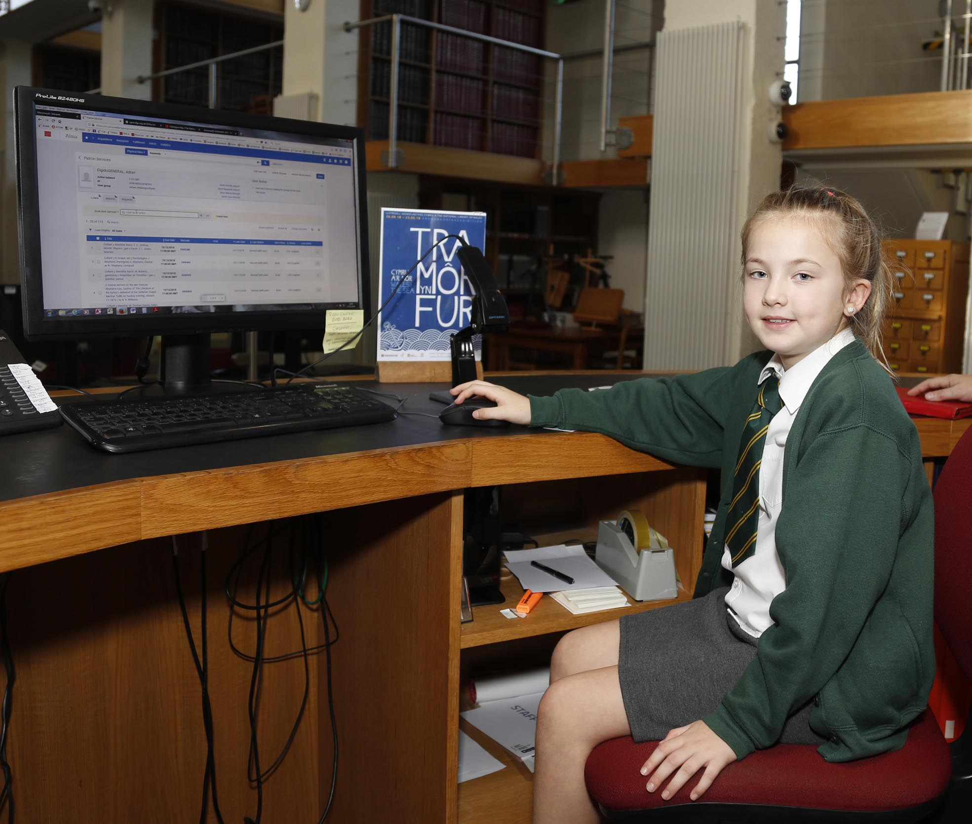 Girl sitting at computer