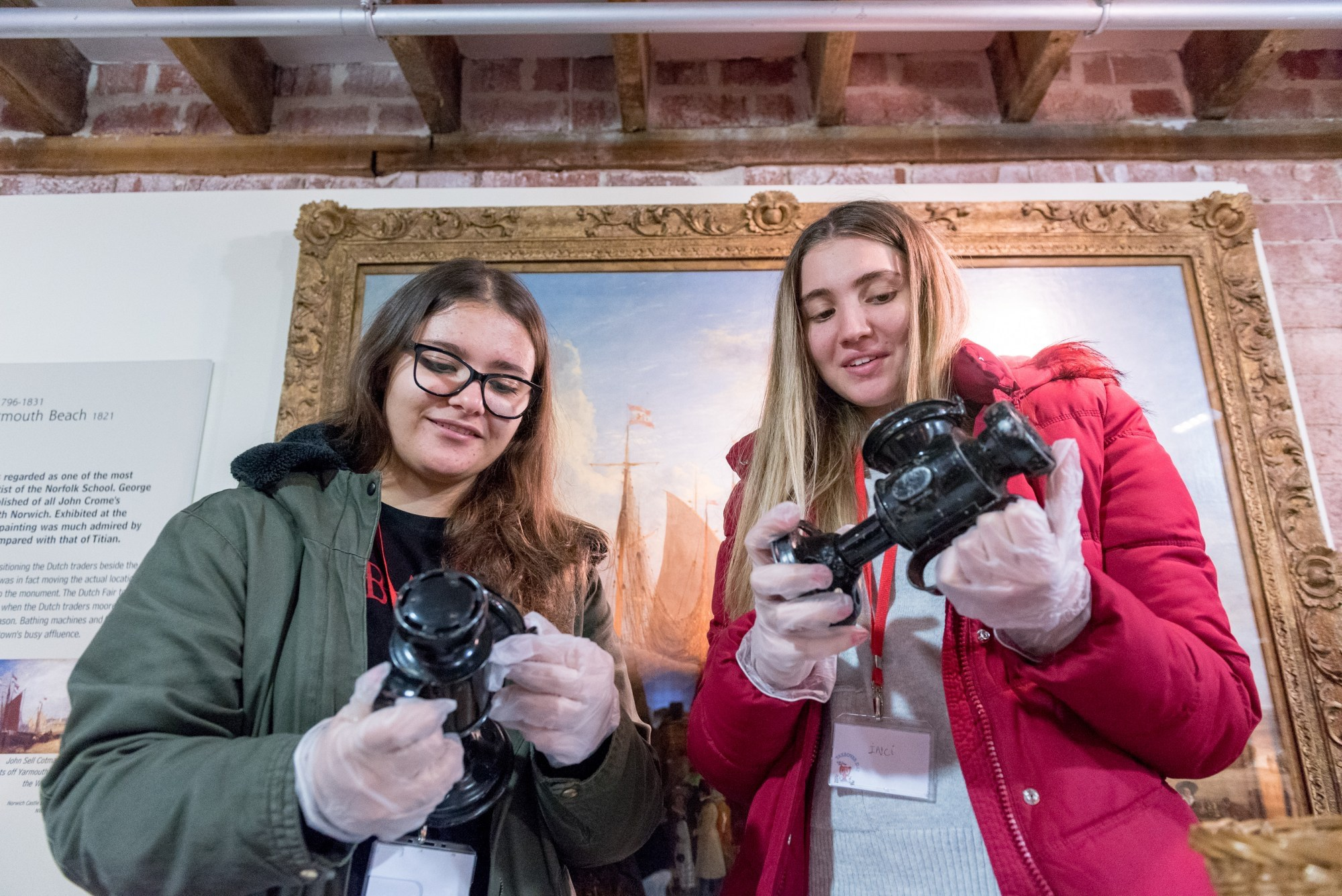 Two girls looking at museum artefacts