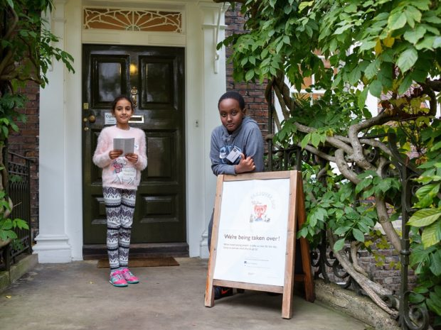 Two young children stand outside Burgh House and Hampstead Museum next to a Takeover Day poster.