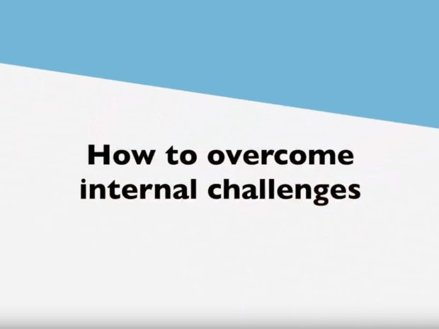 A still from a film showing the text 'How to overcome internal challenges'.
