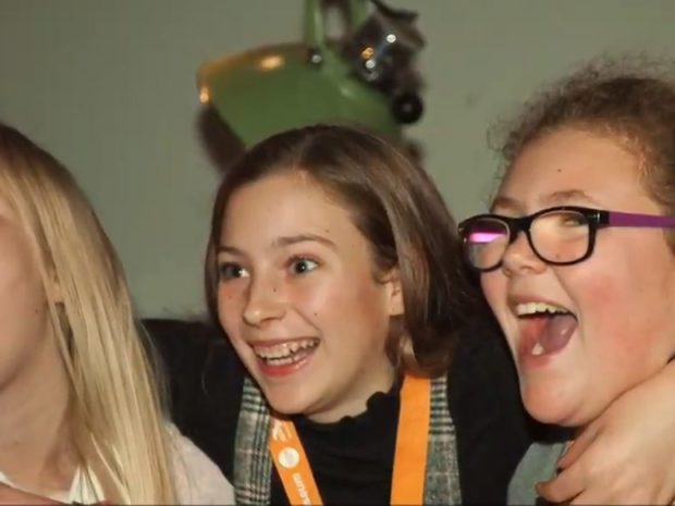 A still from the film showing smiling Takeover Day participants at Poole Museum.
