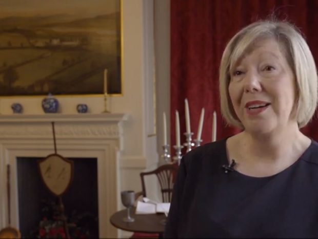 A still from a film showing Chrissie Lackey, front of house coordinator, is talking about Takeover Day at Llanelly House.