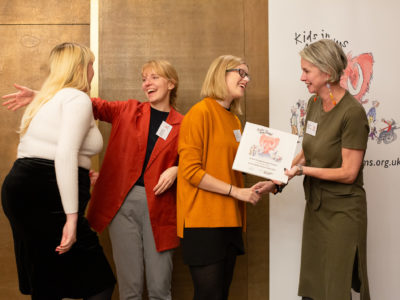 Staff members from the Andrew Carnegie Birthplace Museum look excited as they are are presented with the Family Friendly Museum Award.